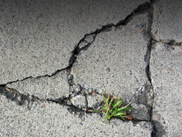 Cracked concrete in need of repair